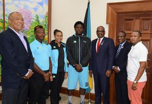 .  Pictured from left are Wellington Miller, Chairman, Bahamas Commonwealth Youth Games Organizing Committee; Michael Butler, soccer; Katelyn Cabral, swimming; Julian Laing, Rugby; Prime Minister Minnis; the Hon Michael Pintard, Minister of Youth, Sports and Culture and Derron Donaldson, Chief of Mission, Team Bahamas.
