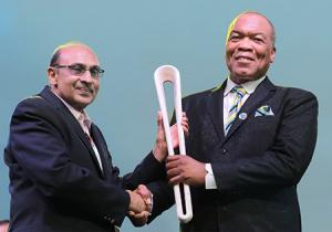 Chairman of the Bahamas 2017 Commonwealth Youth Games Organizing Committee Wellington Miller, right, received the Queen's Baton from Commonwealth Games Federation Regional Vice-President for the Americas K.A. Juman-Yassin at the Official Opening of the games at the Thomas A. Robinson National Stadium, July 18, 2017 -- comprising the first leg of the Baton's trek through the Americas.     (BIS Photo/Derek Smith)