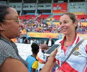 BIS Writer Gena Gibbs interviews Keri Algar about the Queen's Baton Relay. (BIS Photo/Derek Smith)